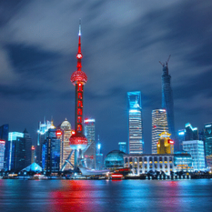 A skyline of a Chinese city shot over water.