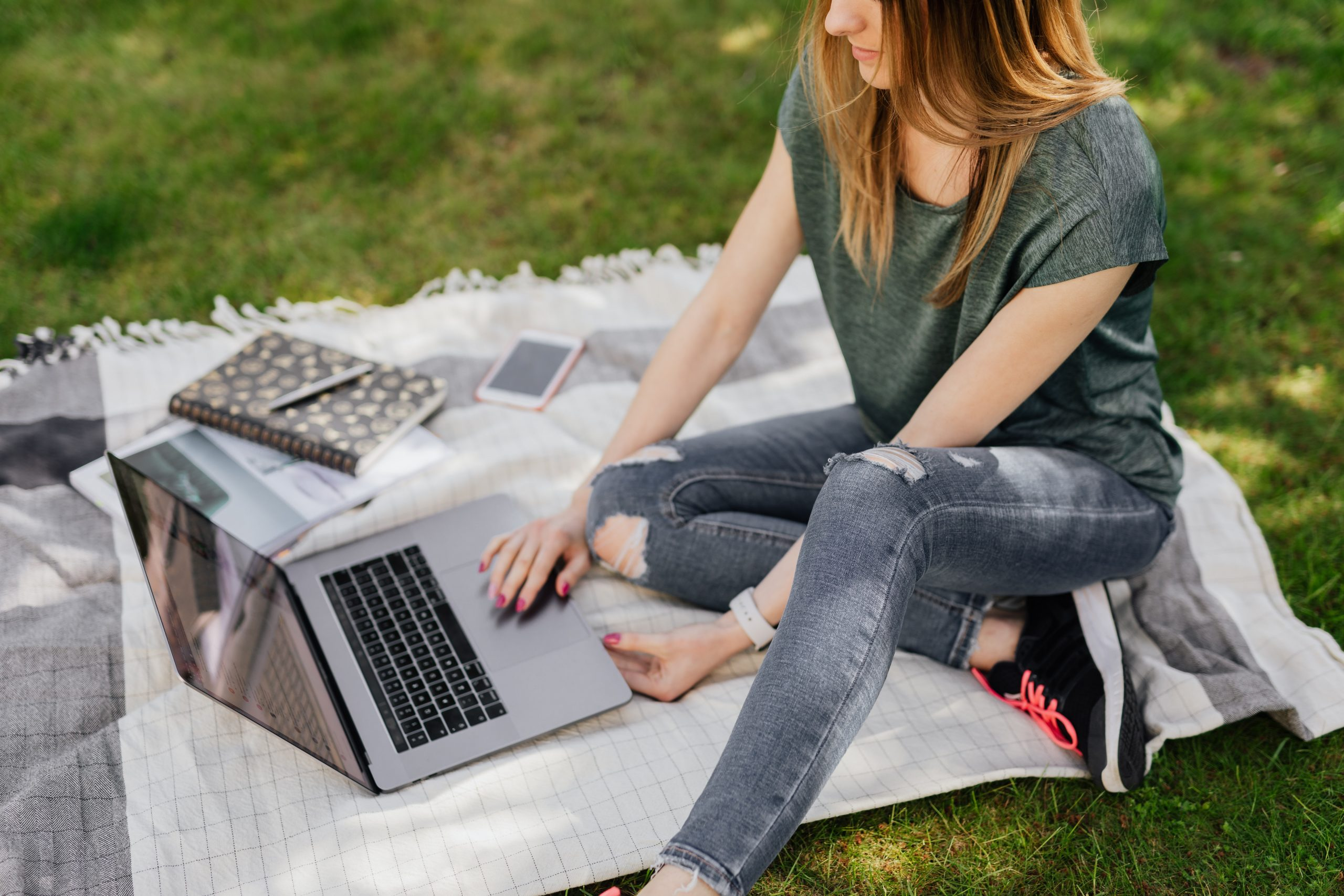College student studying outside on campus